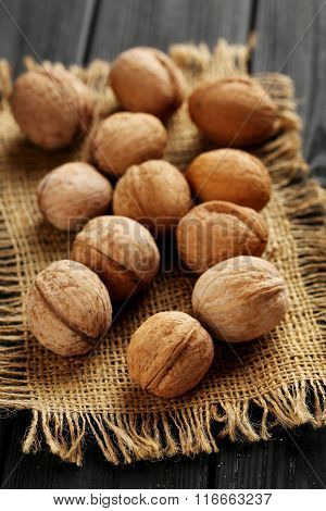 Walnuts On A Black Wooden Table