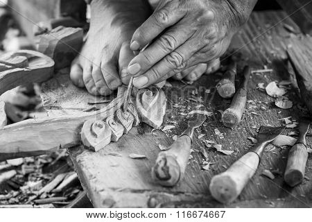 Hand Of Carver Carving Wood In Blackand White Color Tone