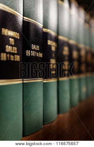 Close up of several volumes of law books of codes and statutes for Sales