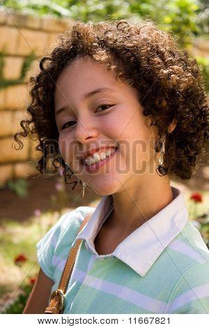 Portrait Of Smiling Teenager Girl Outdoor