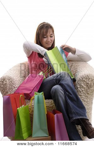 Girl Looking In Her Shopping Bags