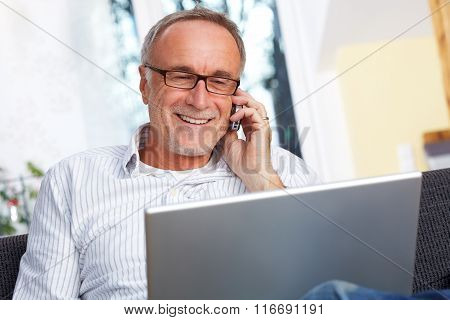 Senior Man With Laptop Mobilephone