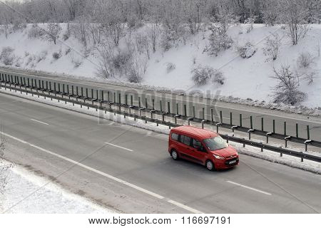 Bucharest Romania 23 January 2016: A red cars passes the high-speed A2 the main commercial route which connects Bucharest to the Black Sea's port Constantza.