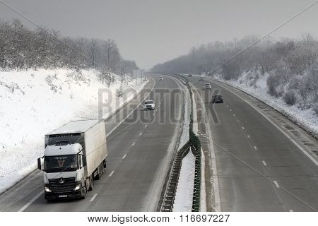 Bucharest Romania 23 January 2016: Cars and lorries are passing the high-speed A2 the main commercial route which connects Bucharest to the Black Sea's port Constantza.