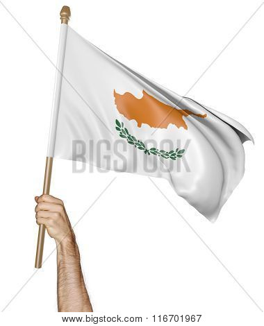 Hand proudly waving the national flag of Cyprus