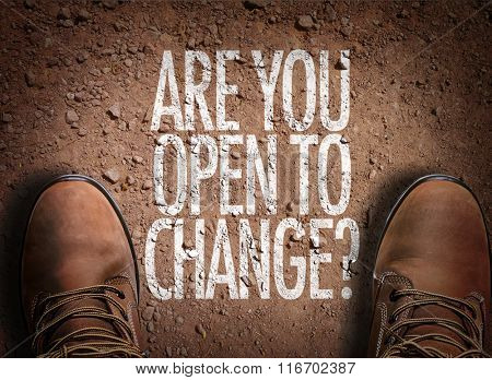 Top View of Boot on the trail with the text: Are You Open To Change?