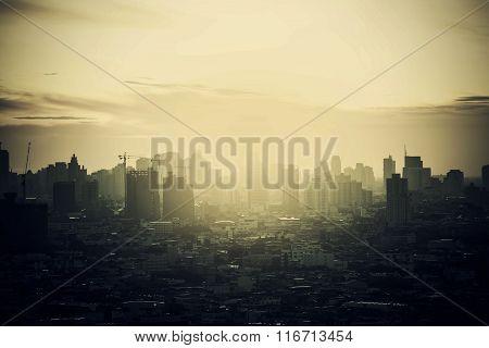 Hazy Skyline Of Bangkok City At Dawn, Smoke With Sunrise.