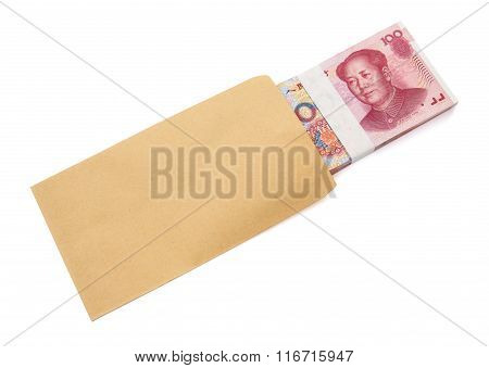 Stack Of Rmb Paper Currency Half In An Envelope With Clipping Path