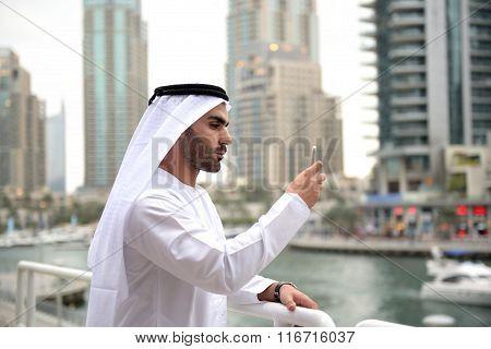 Young Emirati arab man taking selfie