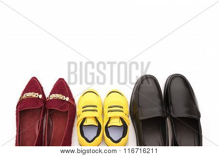 Top View Shoes For Dad Mom And Son On A White Background