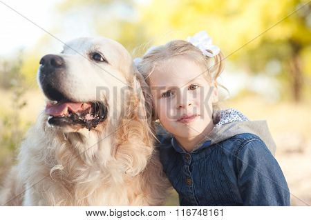 Smiling kid with dog