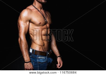 Muscular and sexy torso of young man in jeans