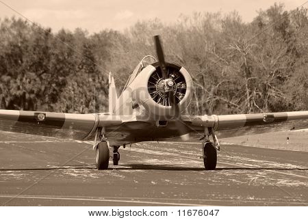 World War II era propeller airplane on the ground poster