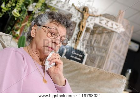 Elderly lady in funeral parlour