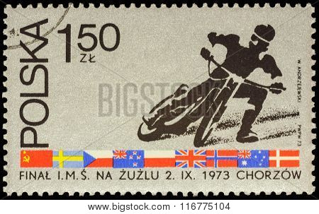 Motorcycle Racer On Postage Stamp