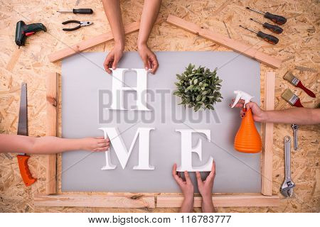 Picture of creating home word on hardboard poster