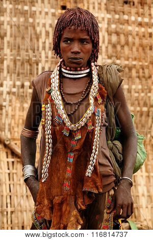 Ethnic  Hamer Woman In The Traditional Dress From Ethiopia