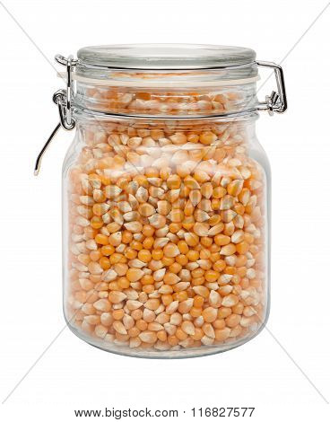 Uncooked Popcorn In A Glass Canister