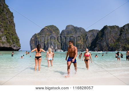 PHI PHI ISLANDS, THAILAND - CIRCA FEBRUARY, 2015: People relax on the famous beach of Maya Bay on Phi Phi Leh island. It starred the popular movie The Beach with the actor Leonardo DiCaprio