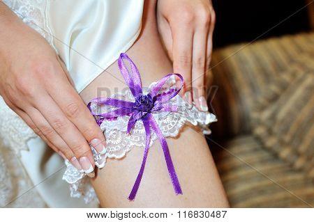 Bride Dresses Garter On The Leg