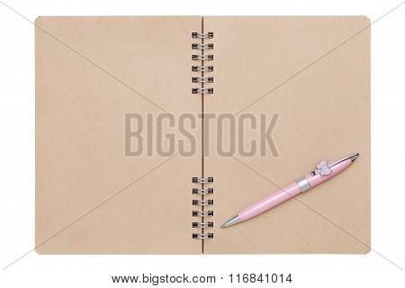blank spiral notebook with ballpoint