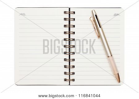 blank spiral notebook with ballpoint