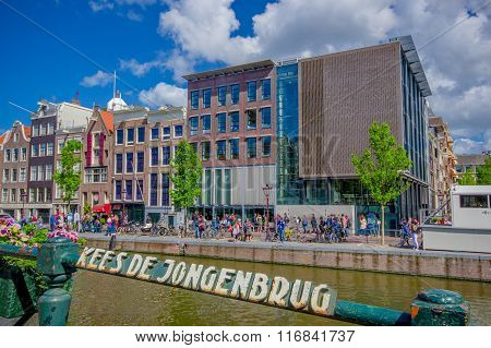 Amsterdam, Netherlands - July 10, 2015: Traditional Dutch city blocks with charming red brick buildi