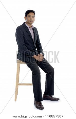 Indian Male Sitting On Chair