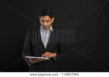 Indian Business Man With A Tablet And Dark Background