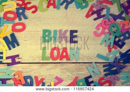 Bike Loan Word Block Concept Photo On Plank Wood