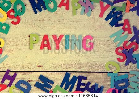 Paying Word Block Concept Photo On Plank Wood