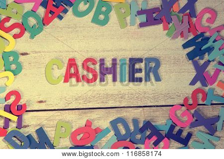 Cashier Word Block Concept Photo On Plank Wood