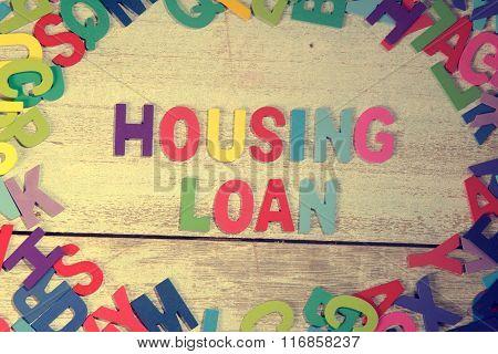 Housing Loan Word Block Concept Photo On Plank Wood