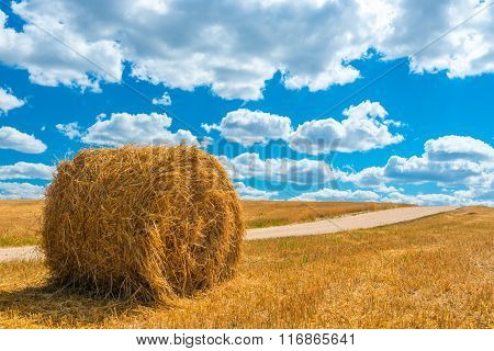 Rick Of Dry Hay On A Golden Mown The Field On A Sunny Day