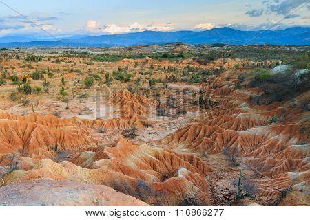 sunset in red desert, tatacoa desert, columbia, latin america, clouds and sand, red sand in desert