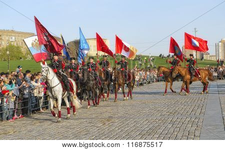 Horsemen of the Kremlin Riding School with the flags of the hero-cities horse show on Poklonnaya Gor