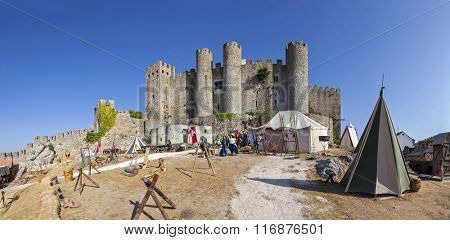 Obidos, Portugal - August 09, 2015: Obidos Castle during the Medieval Fair reenactment. Obidos is a medieval town inside walls, and very popular among tourists.