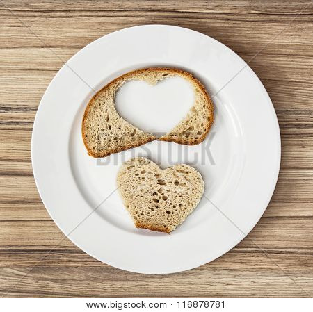 Sliced Wheaten Bread In The Heart Shape On The White Plate, Valentine's Day