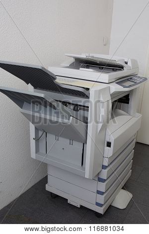 Modern Photocopier With Digital Display Isolated At Office