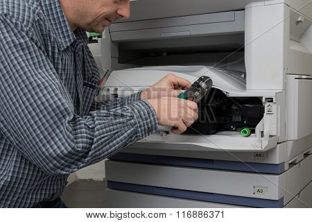 Trying To Repair The Office Printer At Work