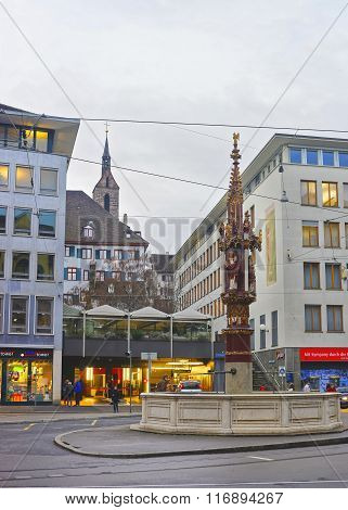 BASEL SWITZERLAND - JANUARY 1 2014: Street view with Fountain in the Old Town in Basel. Basel is a third most populous city in Switzerland. It is located on the river Rhine.