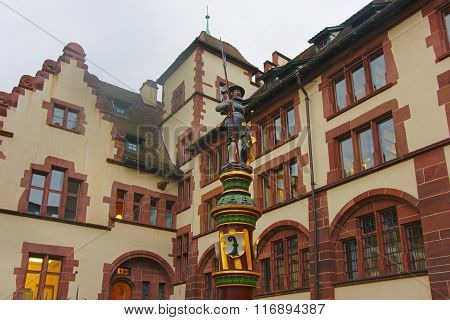 BASEL SWITZERLAND - JANUARY 1 2014: Street view with Fountain in the Old City in Basel. Basel is a third most populous city in Switzerland. It is located on the river Rhine.