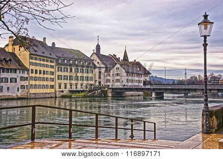 Embankment of Aare river in Solothurn in Switzerland. Solothurn is the capital of Solothurn canton in Switzerland. It is located on the banks of Aare and on the foot of Weissenstein Jura mountains poster