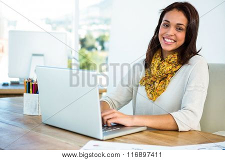Young girl uses his computer in an office