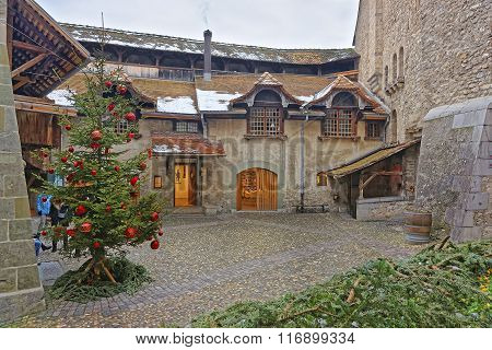 VEYTAUX SWITZERLAND - JANUARY 2 2015: View to Courtyard of the Chillon Castle with Christmas tree. It is an island castle on Lake Geneva (Lac Leman) in the Vaud between Montreux and Villeneuve.