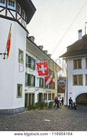 THUN SWITZERLAND - JANUARY 1 2014: Krone Hotel and Flags in the City Hall Square of Thun. Thun is a city in Swiss canton of Bern where Aare river flows out of Lake Thun