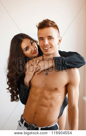 Beautiful Cheerful Young Couple. Guy With Naked Body