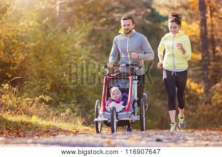 Young family running