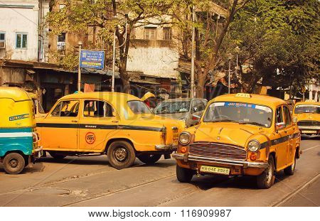 Yellow Taxi Car Driving On The Busy Street Of Indian City