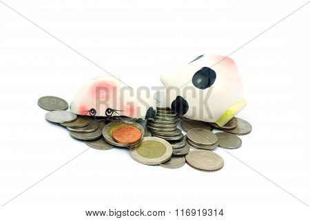 Thai Stack Coins With broken Piggy Bank On White Background